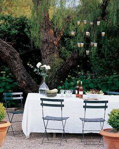amazing tree, gravel, cafe chairs, vino + salad  - so magnifique