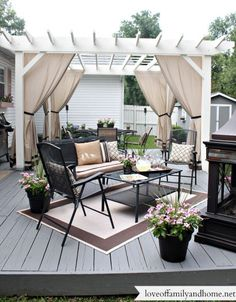 You don't need to travel far for a relaxing outdoor retreat. Turn your backyard into a beautiful oasis with one of these pergola ideas. We found free pergola plans, as well as fun decorating ideas for existing patio and porch covers. Pergola Curtains, Wood Pergola, Deck With Pergola, Backyard Pergola, Modern Pergola, Outdoor Curtains For Patio, Free Standing Pergola, Low Deck, Rustic Pergola