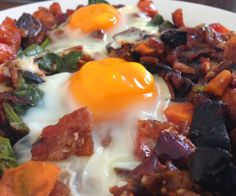 Baked eggs on a bed of bacon, chorizo and sweet potato.  http://stalkerville.net/ #paleo