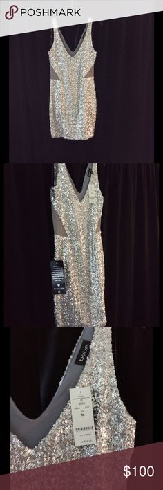 BEBE silver sequin dress Sleeveless silver mini dress. Never worn. It stretches and is super comfortable. bebe Dresses Mini