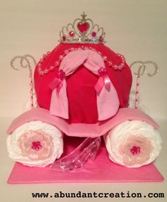 Cinderella Diaper Cake. Diapers, blankets and washcloths are included but no Prince Charming. Perfect gift for your princess baby shower.