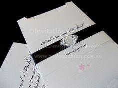 Pocket wedding invitation with crystal brooch by www.tangodesign.com.au #Sleeve #Pocket #Wedding #Invitates #bling