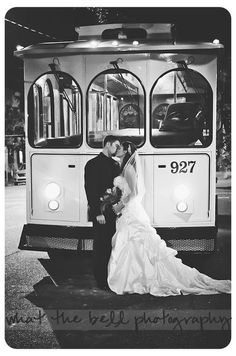 wedding couple in front of trolley