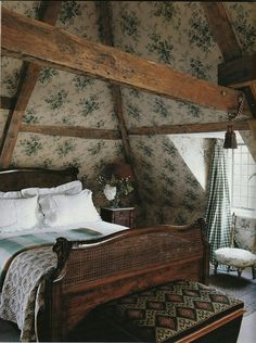 Cozy attic bedroom with vintage floral wallpaper (walls and ceiling), wood furni. - Cozy attic bedroom with vintage floral wallpaper (walls and ceiling), wood furniture, and exposed beams. Beautiful Bedrooms, Interior, Traditional House, Home, Country Decor, House Interior, English Cottage Decor, Cottage Interiors, English Manor Houses