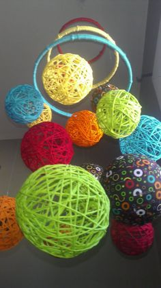 Yarn Ball Crib Mobile on Etsy.  This would be perfect for my anti-theme nursery.