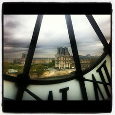 The Louvre through the clock at Musee D'Orsay, Paris