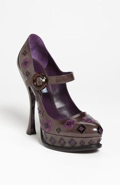 Prada Flower Appliqué Pump: now where is that spare $950?  Oh right, it's nonexistent.  That's ok, I love the shoes but hate the buckle.  :)