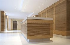 reception counter with wood - Google Search