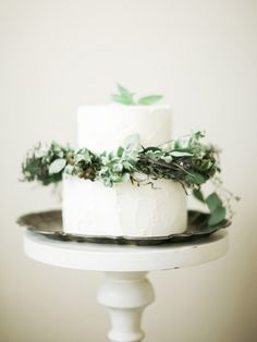 Gorgeous small two tier wedding cake with pretty leaves and natural greenery