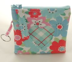 These mini make up bags are in our Folksy shop now. They are fully lined, they have cut out heart shaped detail on the front, matching oilcloth zipper tags and have a handmade by Fabric8e key ring at the side. Have a look at: http://folksy.com/items/4438238-Handmade-Cath-Kidston-Oilcloth-Heart-Detail-Mini-Make-Up-Bag