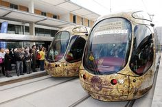 People attend the inauguration of the 3 and the 4 tramway lines of Montpellier, Southern France. The trams, sold by Alstom Transport, was designed by French designer Christian Lacroix. (AFP)