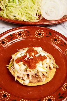 Chicken tostada topped with shredded lettuce, sliced onion, crema, ranchero cheese and homemade salsa roja. Great for parties and get-togethers. Easy kid friendly recipe that's fun to make.