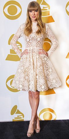 Taylor Swift showed off her sexy legs by wearing her lacy cream-colored Maria Lucia Hohan dress at the Grammy nominations concert in Nashville.