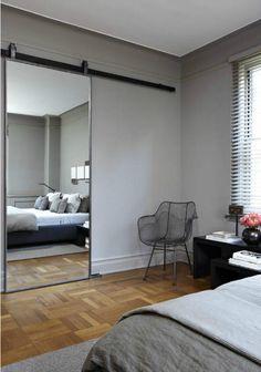 Simple stylish grey bedroom. Loving the industrial slider/mirror to en suite...