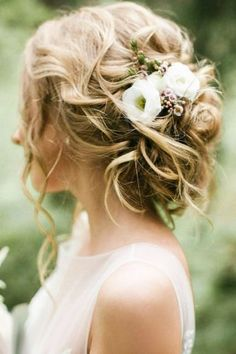 wedding bun hairstyles messy with flowers weddingstylist