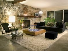 A stone wall beautifully complements the design of a living room. You can see that in the gallery featuring 19 glorious living rooms with stone walls.