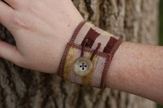 Fabric Cuff Bracelet with Button. $14.00, via Etsy.