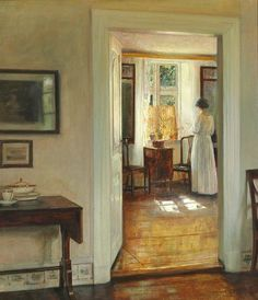 Interior with the painter's wife reading at the window, sunshine, Carl Holsøe. Danish (1863 - 1935)