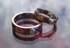 Handmade wedding rings in 14K white gold and diamonds. The customer designed the engravings, that are handmade and filled with pure gold.