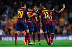 Alexis Sanchez (2nd L) of FC Barcelona celebrates with his team-mates after scoring his team's first goal during the La Liga match between FC Barcelona and Real Valladolid CF at Camp Nou on October 5, 2013 in Barcelona, Catalonia.