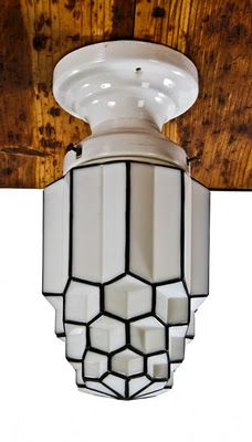 1920s pendant light with baked black enameled accent.