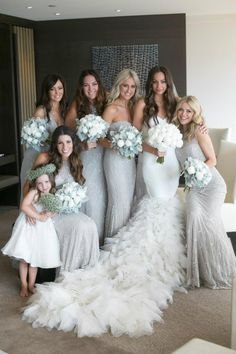 the bridesmaid dresses are amazing, flowers are phenomenal. whole picture is wonderful. The bride is truly a standout with that train!