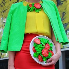 Dutch artist Rommy Kuperus designs with three F's in mind: food, fashion, and fun. To complete her colorful and expressive outfits, the creative dresser pr