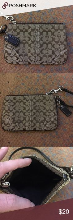Coach Wristlet Coach wristlet, only used a handful of times.  In like new condition.  From a smoke free home. Coach Bags Clutches & Wristlets