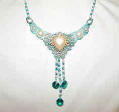 FUF~02/06/15~Shades of Aqua~Designed using B'sue Boutiques raw brass crescent and filigree findings colorized with alcohol inks and Lumiere paints. Accented with pearls, spectra beads and crystals.