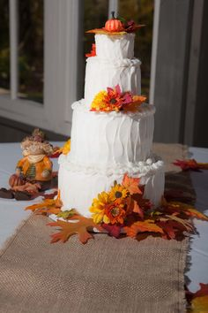 tiered white wedding cake with fall colored accents.    borterwagner photography    borterwagner.com