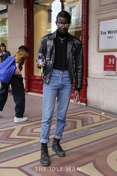 Men's Street Style at Paris Fashion Week | Military Style - Fans of military style unite. The Schott Leather Jacket is the perfect addition to this look. Wear it over a roll neck jumper and tapered jeans. Throw on a pair of aviators to finish it off. | Shop the look now at The Idle Man