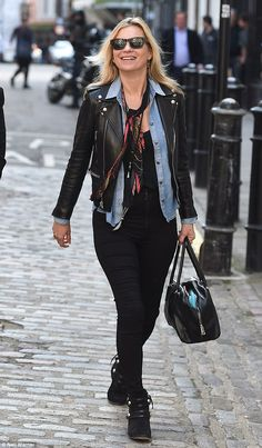 Pizza time: Kate Moss couldn't contain her joy as she headed toPizza Pilgrims in London on Thursday for a lunchtime treat