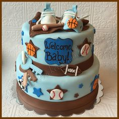 Welcome Baby! Sports themed baby shower. Baby Boy. Renee's WICKED GOOD Cakes - like us on facebook!  Follow us on instagram @renees_wicked_good_cakes
