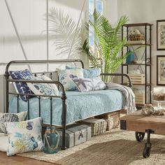 Evoke the charm of a seaside cottage or a vintaged farmhouse on a prairie with the Berwick daybed. The simple, openwork metal frame finished in an antique bronze-hued powder coating brings a touch of rustic style to any room. Place it in the guest suite to add an extra spot for visitors to sleep and pair it with a white-wood and weathered theme of furnishings to create a coastal aesthetic. Then top it with white, light blue, or beach-themed blankets and pillows for a completed look. Take an…