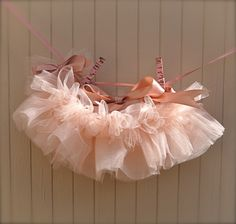 Newborn Tutu--Baby Ballerina Antique Pink . Teeny, tiny and can be hung in the nursery. Clothes pins and ribbon included. $70.00