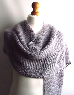 This shawl is knitted holding 1 strand of each yarn together. The Kid Seta adds extra softness and an incredible drape.