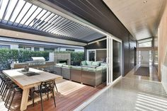 Dark painted timber interiors with polished concrete floors. A statement entrance and an etxra wide passage make a huge impact Outdoor Areas, Outdoor Rooms, Outdoor Living, Outdoor Decor, Turtle Beach, Alfresco Designs, Patio Enclosures, Alfresco Area, House Deck