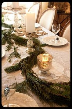 It's starting to look like Christmas! Pretty boughs of greenery from your yard intertwined with candles is an easy way to make your table festive. What else would you decorate with greenery?