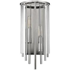The Lewis wall sconce by Hudson Valley features a backplate and half drum in polished nickel, with crystal and metal rods to showcase interior candlecups.