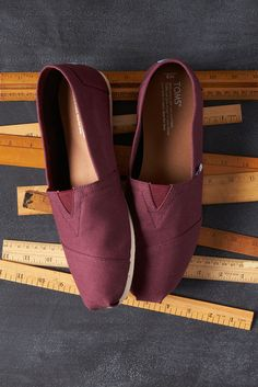 Go back to school in style with Red Mahogany TOMS Slip-on shoes.