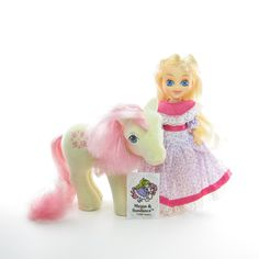 This vintage G1 My Little Pony set is Megan and So Soft Sundance from Year 4. It comes with Megan, So Soft Sundance, and the original body sticker. This set is a slightly different version of Megan an
