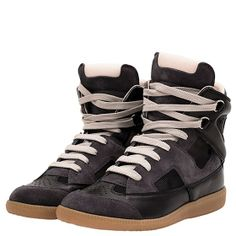 Martin Margiela Fall 2013 Collection  High top sneaker in shades of black kid leather and suede with cut-out details lined in black mesh fabric, laces, and perforated detailing.   Italian sizing.