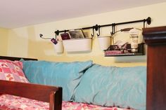 IKEA fintorp mounted on the wall aove bunkbed - STORAGE IDEA