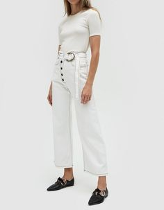 NOTE: UK SIZES LISTED Tailored jeans from Rejina Pyo in White. High rise. Faux button front with zip closure. Self belt with ring buckle adjustment. Classic four-pocket styling. Straight leg. Contrast black topstitching. Ankle length. • No-Stretch