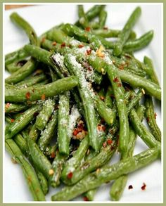 ~Roasted Green Beans~ **Ingredients** 2 pounds Green bean, washed, dried ● 3 Clove Garlic, minced ● 1⁄2 Tbsp Olive oil ● 3 Pinches Sea Salt ● Red pepper flakes to taste ● 2 Tbsp Grated Parmesan cheese ● **Directions** Preheat oven to 425° F. Snap the end off of the green beans and place in a bowl. Drizzle with olive oil. Just a few drops to lightly coat the green beans. Mix in the minced garlic and salt. Place green beans on a baking sheet lined with non-stick paper. Roast for around 14…
