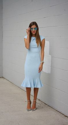 Shop this look on Lookastic:  http://lookastic.com/women/looks/sunglasses-sheath-dress-bracelet-watch-pumps/10669  — Blue Sunglasses  — Light Blue Sheath Dress  — Silver Bracelet  — Gold Watch  — Silver Leather Pumps