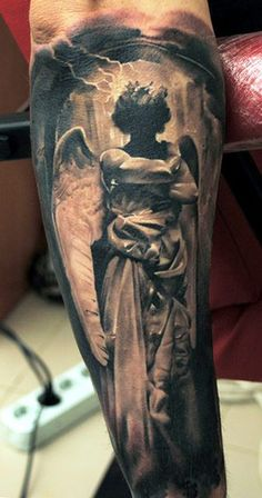 Tattoo Artist - Denis Sivak - angel tattoo I like that the angels face is in the shadows.