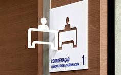 environmental wayfinding signage with perpendicular graphic cut-out