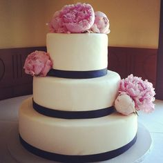 Classic 3-tier #wedding #cake covered in vanilla fondant, trimmed with navy grosgrain ribbon and fresh peonies.