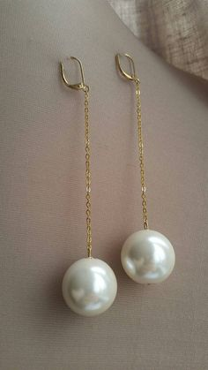 Check out this item in my Etsy shop https://www.etsy.com/ca/listing/265064365/extra-large-pearl-and-gold-dangling